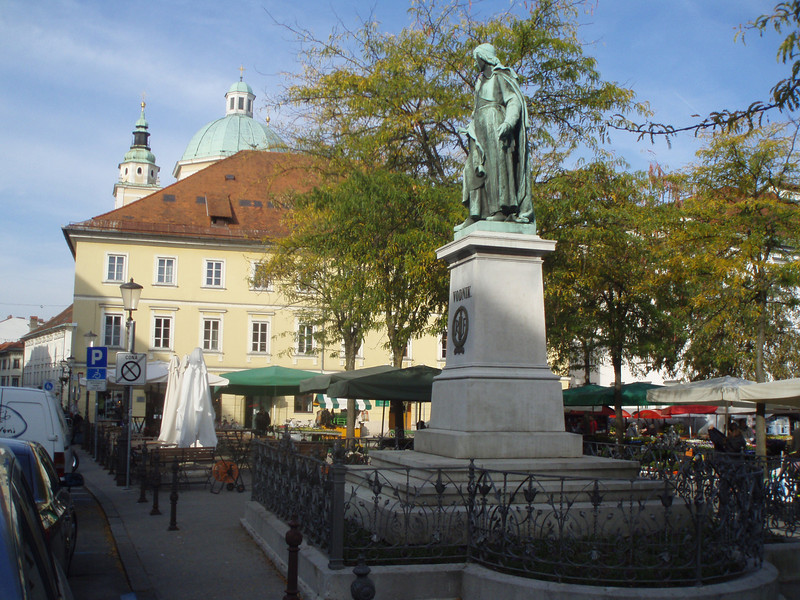 A town square in Ljubljana, with the market in the background