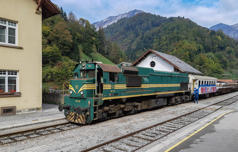 One of the things that gets enthusiasts going to Slovenia is the chance to ride behind big diesel locos on the car carrying train through the Julian Alps. 664-105 is seen at Podbrdo on 18th October 2018