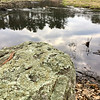 Moss-covered boulders sat along this river in Billerica. Photo by Mary Leach