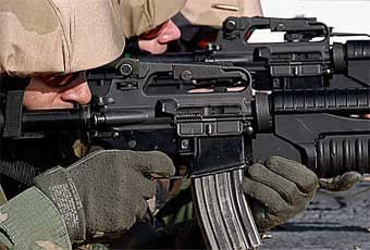 The M203 40mm Grenade Launcher is used while attached to an M16A2 5.56mm rifle. It is a lightweight, compact, breech loading, pump action, single shot launcher.