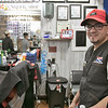Bonao's Barber Shop was full of customers on Saturday, March 14, 2020. Owner Domingo Vicioso, pictured, said that he has only seen a tiny drop in business. They bought rubber gloves and hand sanitizer to help with the coronavirus. They are also cleaning much more then they did before. Vicioso has been in business for 11 years on Main Street in Fitchburg.  SENTINEL & ENTERPRISE/JOHN LOVE
