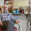 Bob Pelullo in his shop Ideal Barbers on Day Street in Fitchburg, March 14, 2020. He has been cutting hair at this shopo since 1961. His father opened it in 1948. He said that he is not that worried about the virus and this is the first time he has seen anything like this. He said that he has not lost any business due to the virus. It is mostly business as usual but he is not really sure how it will effect his business. This is the first time in all his years that he has seen any thing like this. He has bought more hand sanitizer for the shop. SENTINEL & ENTERPRISE/JOHN LOVE