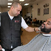 "Thurston Silva from Gardner gets his hair cut from owner of Brother's Barbershop on Main Street in Fitchburg Luis Feliciano Saturday, March, 14, 2020. The shop was full of customers coming and going. Silva said that he is moderately worried about the virus. ""If it is going to happen it is going to Happen."" Owner Feliciano got more hand sanitizer for the shop and Lysol sprays and wipes. He Said that they are prepared to be safe. He also bought mask just in case they need them. His business has dropped a little he said. Most Thursdays there are customers for about 11 hours straight but this past Thursday they only had 3 customers. Some customers are calling and canceling. You would not have know that on Saturday. We are trying to do the best we can to stay safe and we hope they get control if it soon. SENTINEL & ENTERPRISE/JOHN LOVE"