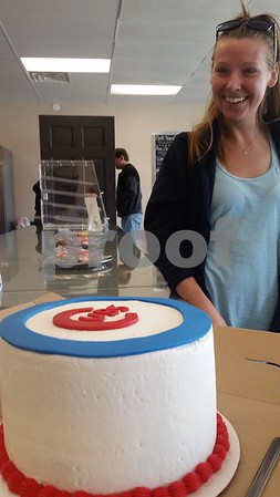 Kelly LePere of DeKalb admires a custom-made Chicago Cubs cake she picked up Monday morning at Smallcakes: A Cupcakery, 817 W. Lincoln Highway, Unit G, for her husband's birthday. The shop features 17 signature cupcake flavors, dog treats, parfaits, gluten-free treats and more.