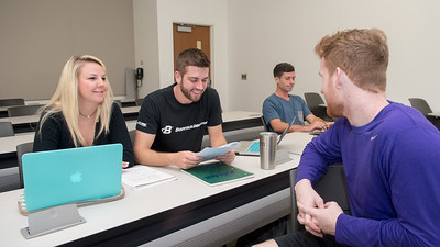 Julie Williams (left), Stephen Gibson, and Blake Cox review for their Marketing Research and Analysis test.
