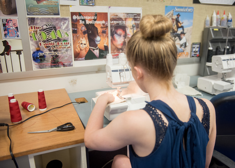 Molly White sews pieces of fabric together with a specific stitch for her Costume Construction class.