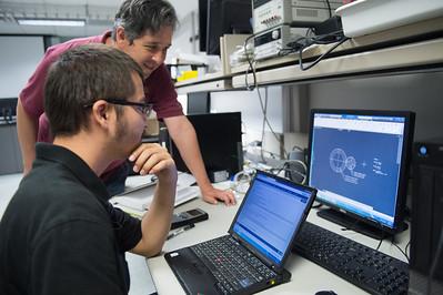 Instructor John Gonzalez assits JRefugio Bchenc with gear design for 3D Printer.