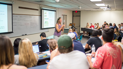 Professor Erika Locke answers students' questions about tectonic plates during her Essentials of Geology lecture.