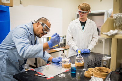 Sagar Shrestha (left) and Mason Maupins prepare water samples while they wait for results from the Solar Simulator.