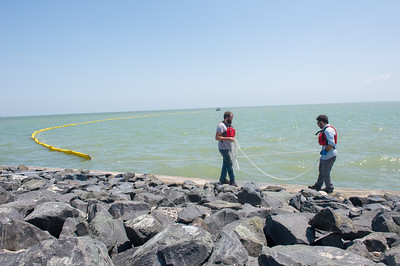 Eli Waddell (left) and Dr. Jeremy Conkle install instruments to assist and collect data from the body of water in the Corpus Christi Bay.