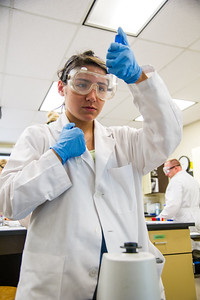 Brianna Rabagos observes her readings in Microbiology lab.