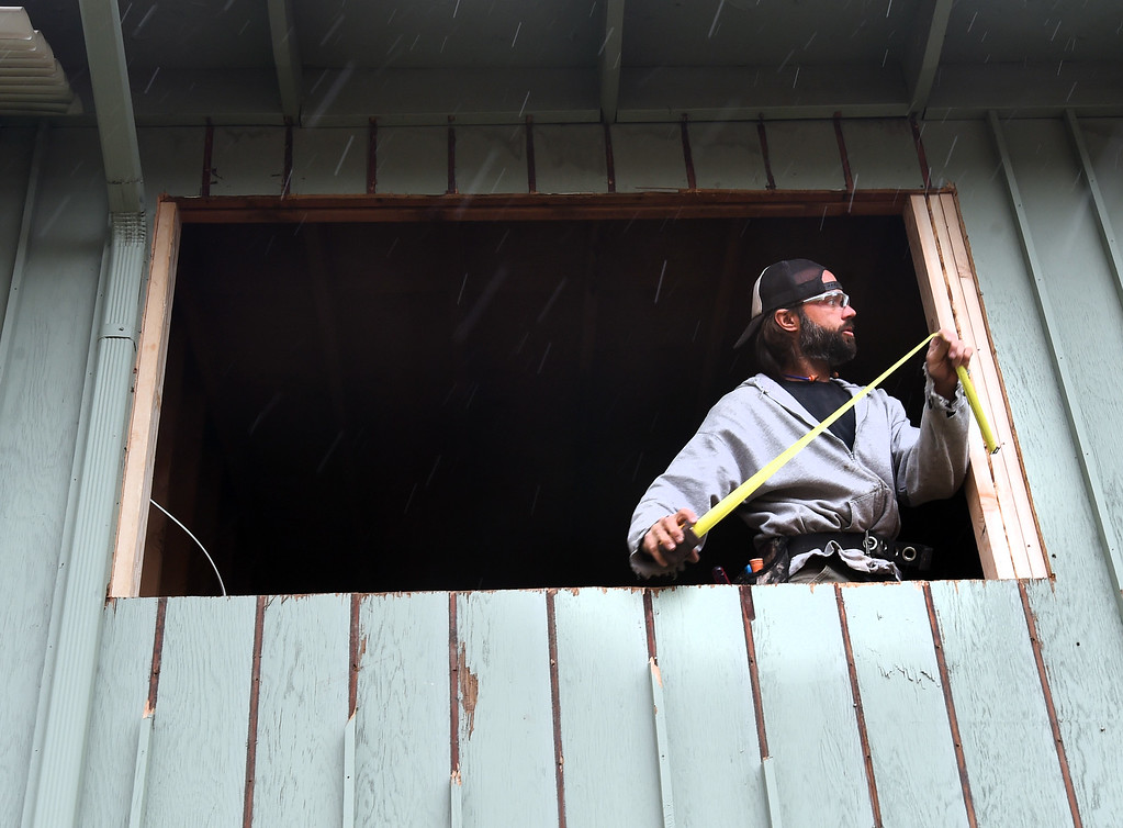 . Ryan Mielke works on a window frame on the complex.  Ryan Mielke and David Ryan do Smart Regs construction work at an apartment complex in Boulder. Cliff Grassmick  Photographer  May 3,  2018