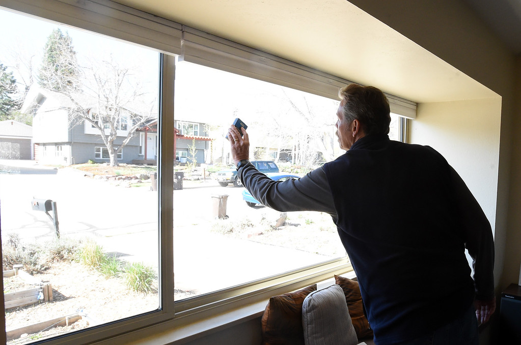 . Kim Davis checks windows for energy efficient improvements. Inspector, Kim Davis, does a Smart Regs inspection on a Boulder Home. As 8-yr Smart Regs program comes to a close, landlords complain of costly upgrades that could force them to raise rents or sell their properties. Cliff Grassmick  Photographer  April 27, 2018