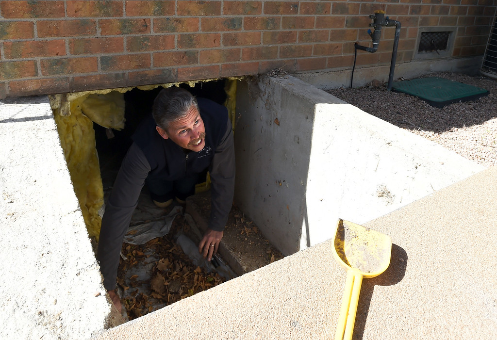 . Kim Davis checks the crawl space to check for energy efficient improvements.  Inspector, Kim Davis, does a Smart Regs inspection on a Boulder Home. As 8-yr Smart Regs program comes to a close, landlords complain of costly upgrades that could force them to raise rents or sell their properties. Cliff Grassmick  Photographer  April 27, 2018