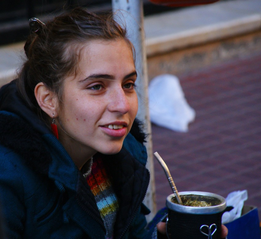 In this daily smiling faces travel photo a local (porteña - resident) from Buenos Aires, Argentina sits down & enjoys a cup of Mate (tea).