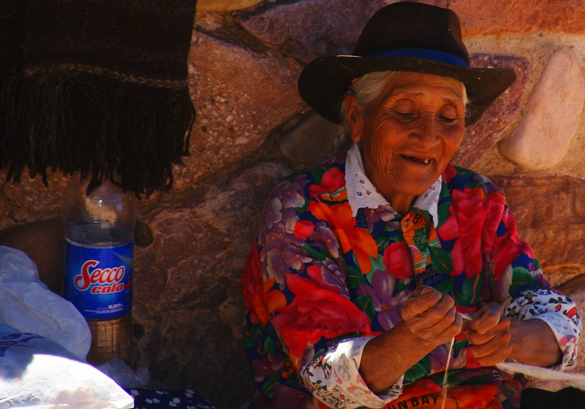 http://smilingfacestravelphotos.com : This daily smiling faces travel photo is of a local lady delighted to be working away at her craft in the Northern region of Argentina.
