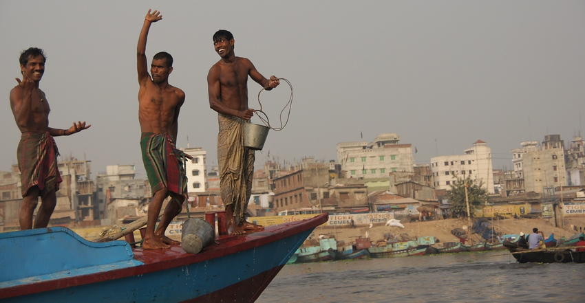 http://smilingfacestravelphotos : A group of men on a larger vessel (sailing along the Buriganga River) started dancing, smiling & laughing as I took their photo.