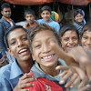 Today's smiling faces travel photo is of a group of Bangladeshi boys smiling and curiously pointing at the camera anxiously waiting for their photo to be taken - Old Dhaka, Bangladesh.