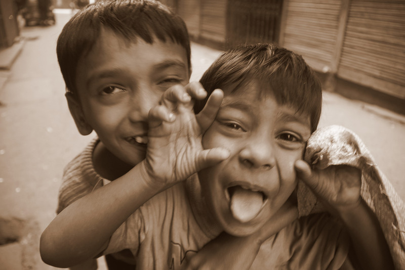 Today's smiling faces travel photo is of two cute Bangladeshi boys smiling & hamming it up for the camera along an alleyway in Old Dhaka, Bangladesh.