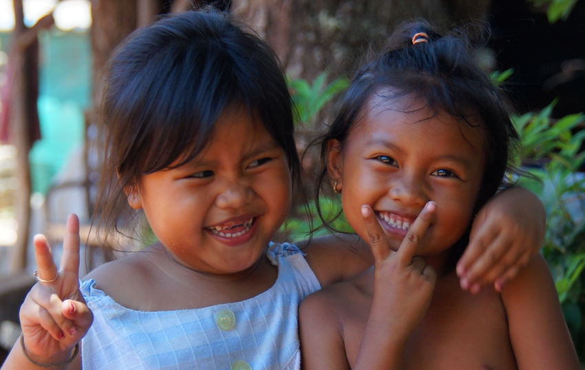 http://smilingfacestravelphotos.com : Two adorable Khmer girls stop to smile and pose for a shot on the out-skirt rural area just outside of Siem Reap, Cambodia.