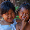 "<a href=""http://smilingfacestravelphotos.com"">http://smilingfacestravelphotos.com</a> : Two adorable Khmer girls stop to smile and pose for a shot on the out-skirt rural area just outside of Siem Reap, Cambodia."