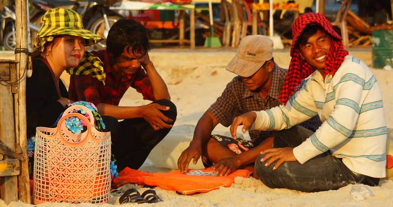 Today's Smiling Faces Travel Photo is of some Khmer men sitting down and enjoying a pleasant conversation with radiant smiles in Sihanoukville, Cambodia.