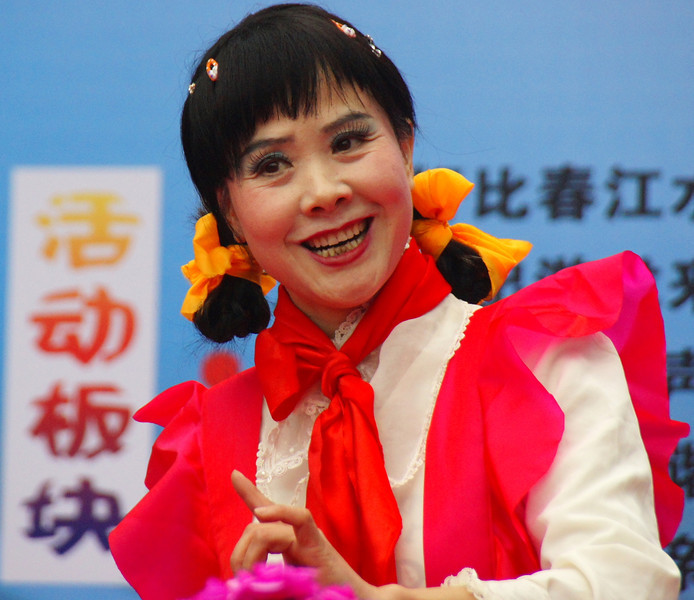 Today's smiling faces travel photo is of a Chinese performer during a Communist rally with a big authentic grin - Guilin, China.
