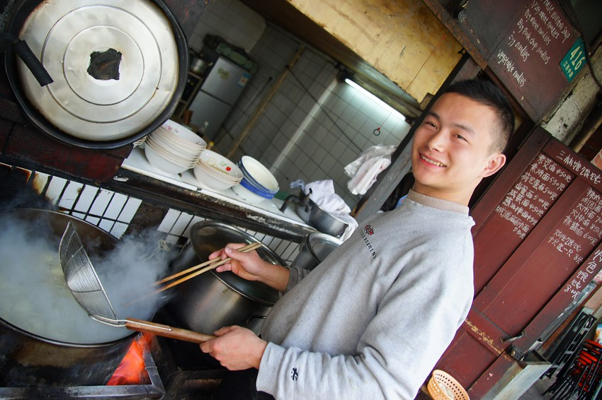 http://www.smilingfacestravelphotos.com/travel-photos/man-cooking-dumplings-shanghai-china-travel-photo : Today's smiling faces travel photo is of a Chinese man making dumpling soup in Shanghai, China. A friendly face with a big grin and service.