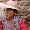 Today's daily smiling faces travel photo is of a Peruvian girl and her baby Alpaca cutely embracing for a kiss and smile in Chivay, Peru.