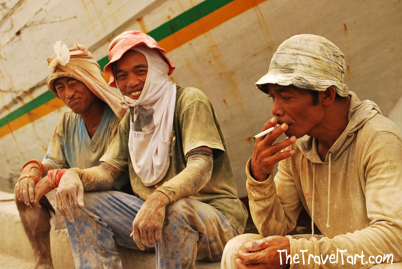 Today's smiling faces travel photo is of three workers taking a well earned break after a few hours of heavy manual labour at Sunda Kelapa harbour, near Jakarta in Indonesia.