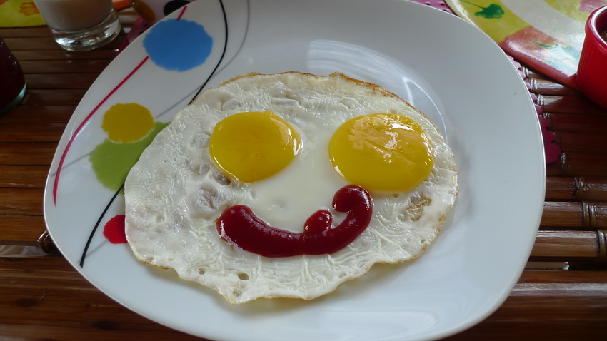 Today's smiling faces travel photo is of a happy breakfast which consists of overly ecstatic smiling eggs - piercing sunny side up eyes with a wry ketchup smile - almost too cute to actually eat.