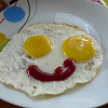 "Today's smiling faces travel photo is of a happy breakfast which consists of overly ecstatic smiling eggs - piercing sunny side up eyes with a wry ketchup smile - almost too cute to actually eat : <a href=""http://www.smilingfacestravelphotos.com/travel-photos/happy-breakfast-smiling-eggs"">http://www.smilingfacestravelphotos.com/travel-photos/happy-breakfast-smiling-eggs</a>"