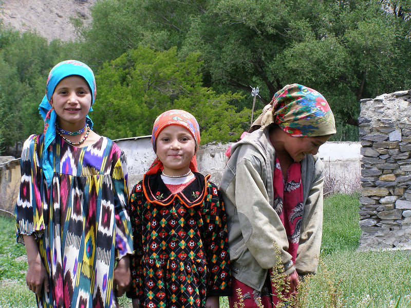 While traveling in the Wakhan Vallery of Tajikistan a group of children dressed in silk were delighted to have their photo taken flashing radiant smiles.