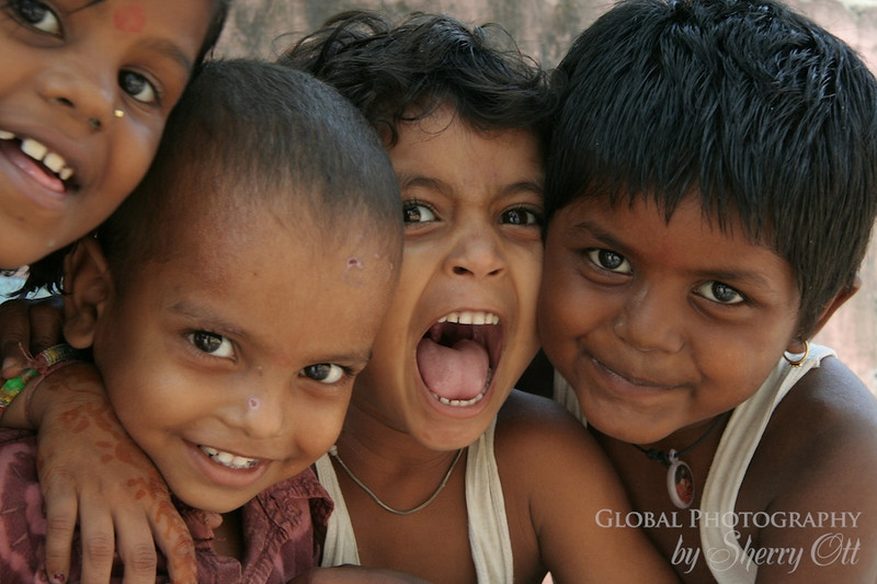 "These smiling, young faces come from Delhi, India.  I took these while on a volunteer assignment in Delhi as part of my career break.  While the mothers were inside learning how to make jewelry, the kids ran around outside with an endless amount of energy.  They love having their picture taken and would all push and shove to get into the shot.  It was wonderful to hear them giggle with excitement when I would show them their photos!  <a href=""http://www.smilingfacestravelphotos.com/travel-photos/smiling-faces-delhi-india"">http://www.smilingfacestravelphotos.com/travel-photos/smiling-faces-delhi-india</a>"
