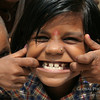 "These smiling, young faces come from Delhi, India.  I took these while on a volunteer assignment in Delhi as part of my career break.  While the mothers were inside learning how to make jewelry, the kids ran around outside with an endless amount of energy.  They love having their picture taken and would all push and shove to get into the shot.  It was wonderful to hear them giggle with excitement when I would show them their photos!<br /> <a href=""http://www.smilingfacestravelphotos.com/travel-photos/smiling-faces-delhi-india"">http://www.smilingfacestravelphotos.com/travel-photos/smiling-faces-delhi-india</a>"