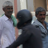 This smiling faces travel photo is of two Indian men grinning at me while walking down a busy street in Jaipur, India.