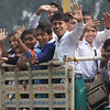 In the featured smiling face of the week I'm sharing a photo of a group of Indian children waving wildly and smiling in the back of a truck in Kolkata, India.