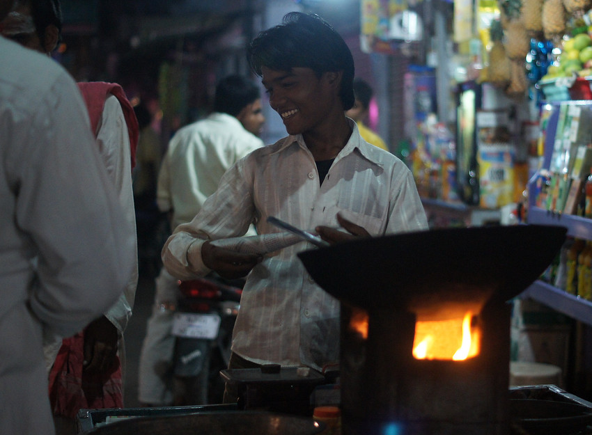 Today's smiling faces travel photo is of an Indian man serving up samosas with a smile on the streets of Pushkar, India at night.