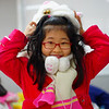 "<a href=""http://smilingfacestravelphotos.com"">http://smilingfacestravelphotos.com</a> : A cute Korean student wearing a warm winter hat, jacket and muffler smiles during a camp class break."