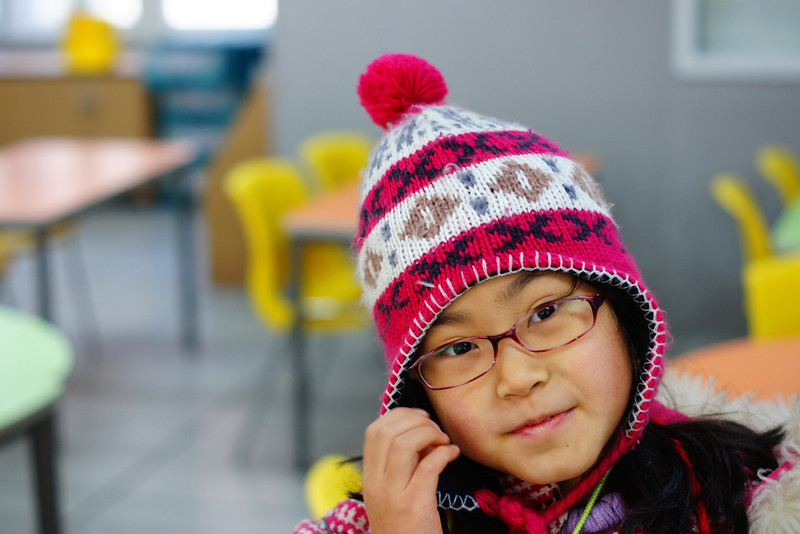Today's smiling faces travel photo is of a cute Korean elementary school student smiling while wearing a warm winter hat during our English Winter Camp.