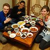 """This is a group shot travel photo of some very hungry travel bloggers joyfully smiling and eagerly anticipating a delicious set Korean meal for lunch.<br /> <br /> <a href=""""http://www.smilingfacestravelphotos.com/travel-photos/travel-bloggers-eager-to-have-a-korean-set-meal"""">http://www.smilingfacestravelphotos.com/travel-photos/travel-bloggers-eager-to-have-a-korean-set-meal</a>"""