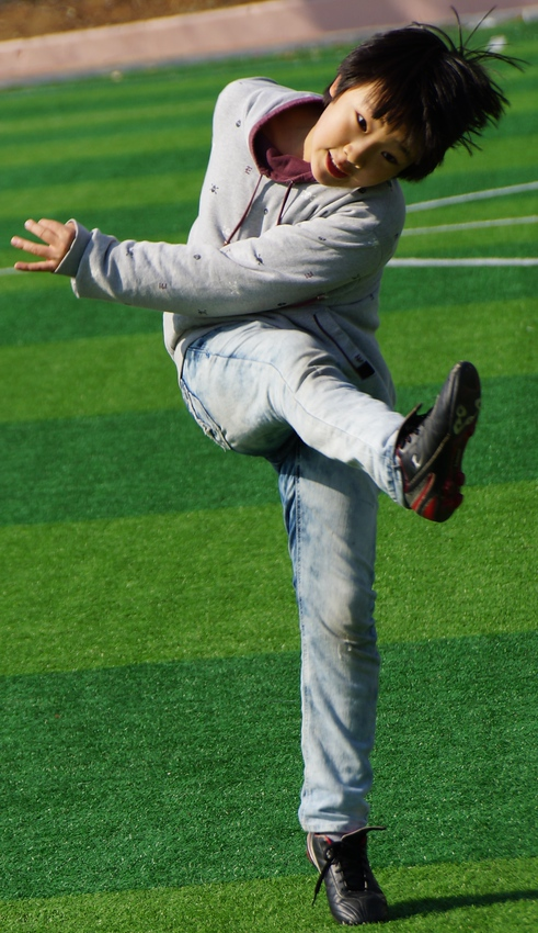 Today's smiling faces travel photo is of one of my former Korean students kicking a soccer ball while clearly smiling and enjoying himself thoroughly.