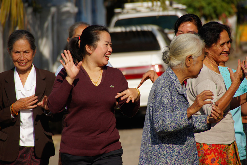 Today's smiling faces travel photo is of a group of Lao ladies dancing on the street to some music from a nearby restaurant in Luang Prabang, Laos.