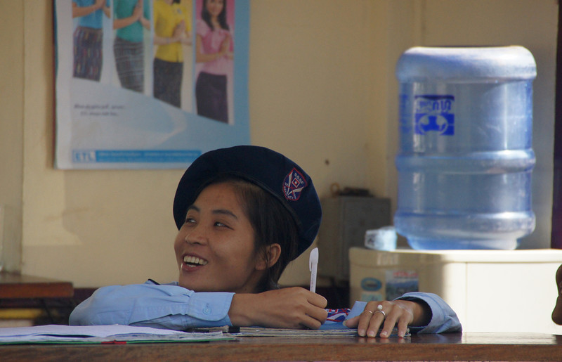 "Today's Smiling Faces Travel Photo is of a smiling officer taking a break from her paper work in the capital city of Vientiane, Laos.<br /> <br /> <a href=""http://smilingfacestravelphotos.com"">http://smilingfacestravelphotos.com</a> :"