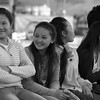 Today's smiling faces travel photo is of a group of Lao women sitting down at a park bench to share conversation, smiles and laughs - Vientiane, Laos.