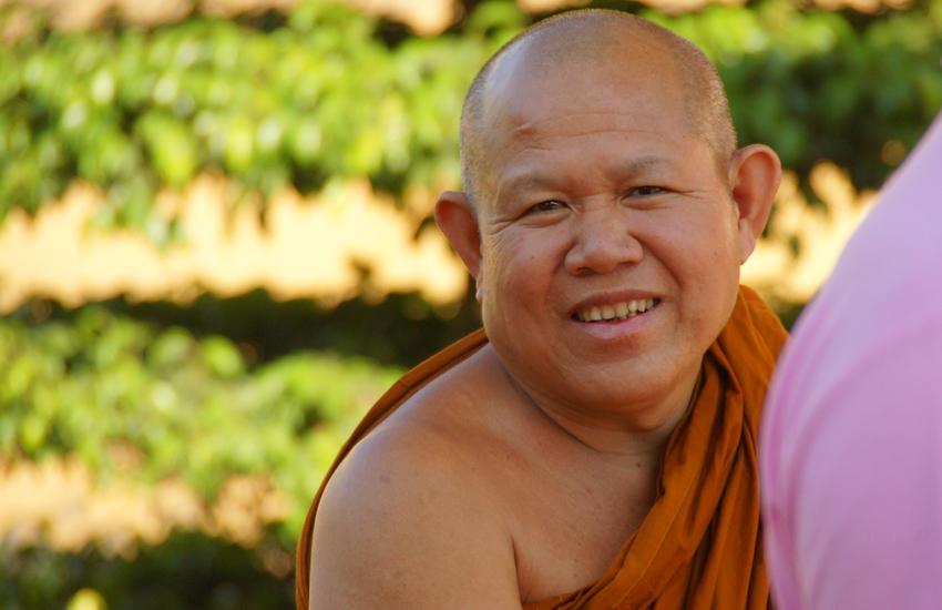 http://smilingfacestravelphotos.com : Daily smiling faces travel photo of a smiling Buddhist monk flashing an authentic from the capital city of Vientiane, Laos.