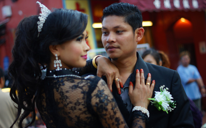 Today's smiling faces travel photo is of a newly-wed couple posing in formal attire along Jonker Street in Melaka, Malaysia.