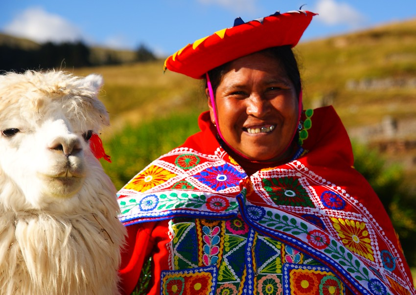 Today's smiling faces travel photo is of a lovely Peruvian lady wearing traditional attire posing with her cute llama in Cuzco, Peru.