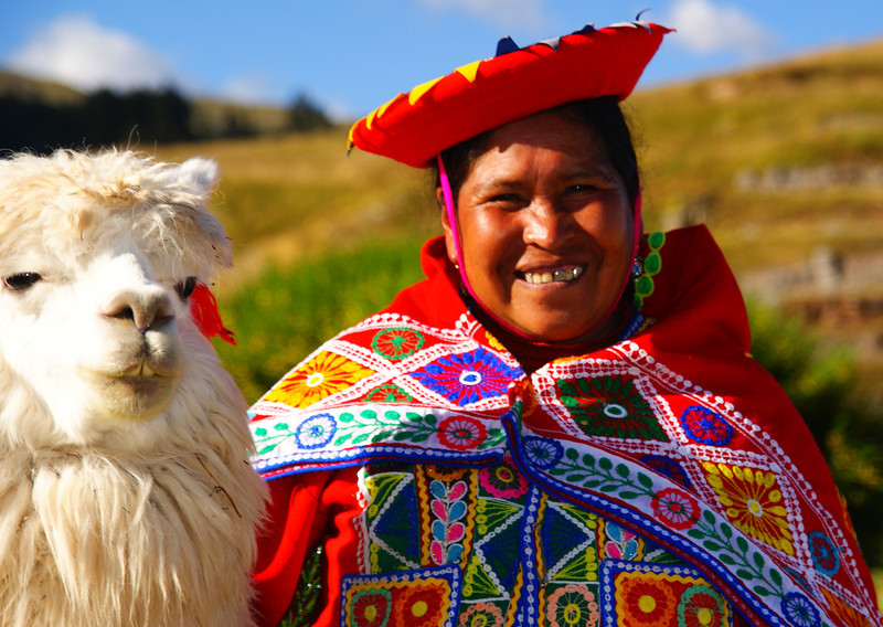 """Today's smiling faces travel photo is of a lovely Peruvian lady wearing traditional attire posing with her cute llama in Cuzco, Peru:<br /> <br /> <a href=""""http://www.smilingfacestravelphotos.com/travel-photos/smiling-peruvian-lady-llama-cuzco-peru"""">http://www.smilingfacestravelphotos.com/travel-photos/smiling-peruvian-lady-llama-cuzco-peru</a>"""