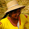 Today's smiling faces travel photo is of a lovely Uros lady smiling on a tatora reed floating island located on Lake Titicaca, Peru.